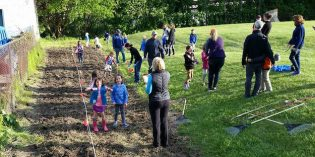 Volunteers Plant Pollinator Garden at Riverside Park