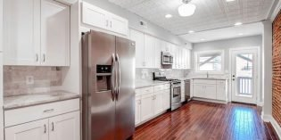 Rental Spotlight: Four-Bedroom Rowhome on Light Street with a Two-Sided Garage and Large Rooftop Deck