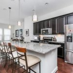 Million Dollar Monday: Three-Bedroom Locust Point Townhome with a Luxury Kitchen, Large Rooftop Deck, and Two-Car Garage