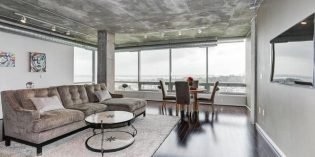 Mid-Week Listing: Silo Point Condo with Panoramic Views, a Luxury Master Suite, and Industrial Charm