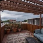 Mid-Week Listing: Three-Level Washington Boulevard Rowhome with Multiple Decks, an Expansive Master Suite, and Parking