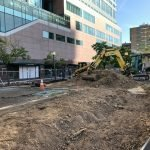 Construction Underway to Remove Berms and Expand Sidewalk on Pratt Street
