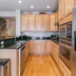 Mid-Week Listing: Well-Maintained Four-Bedroom Locust Point Townhome with a Garage and Rooftop Deck
