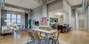 Featured Listing: Stunning Industrial Chic Silo Point Condo with Waterfront Views, a Private Terrace, and Luxury Kitchen