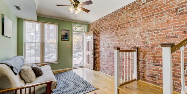 Mid-Week Listing: Charming Locust Point Home with Bonus Rooms, a Fireplace, and a Rooftop Deck
