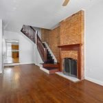 Featured Listing: Three-Bedroom Federal Hill Home with Original Details, Two-Car Parking, and a Rooftop Deck