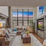 Featured Listing: Stunning Silo Point Condo with Three Bedrooms, a Bonus Room, Viking Appliances, and Concrete Pillars